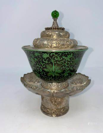 A Tibetan white metal stand and lid with green and black Chinese bowl with character mark to base