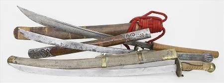 Drei asiatische Schwerter.