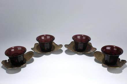 A set of glass cups with silver stands