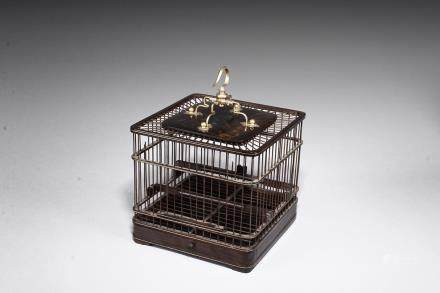 A rosewood square bird cage