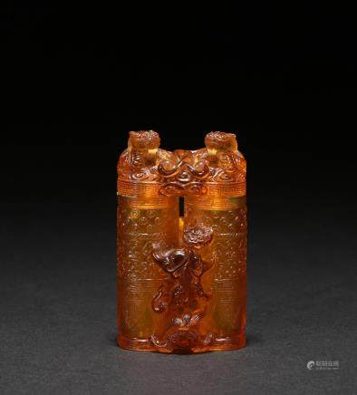 An amber-tone glass champion vase