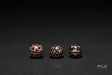 Three Indian dzi beads