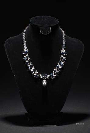 A blue diamond and pearl necklace