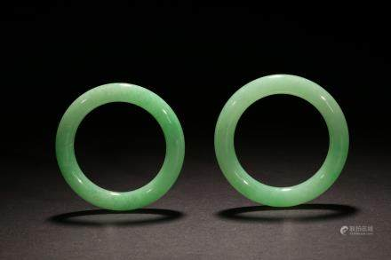 A pair of spectacular translucent jadeite bangles