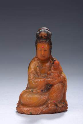 A soapstone carved figure of Guanyin