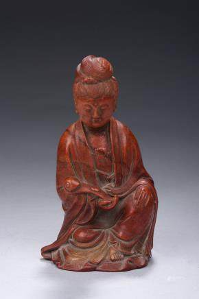 A carved shoushan figure of Guanyin