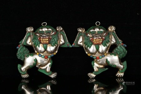 PAIR SILVER LIONS