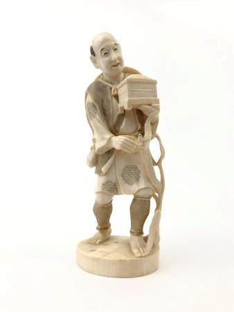 JAPANESE CARVED OKIMONO OF A CRICKET COLLECTOR