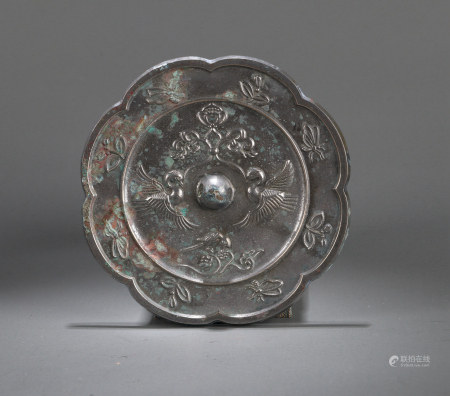 A CHINESE ARCHAISTIC 'PHOENIX AND SUNFLOWER' BRONZE MIRROR, MING OR EARLIER