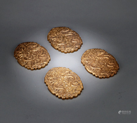 A SET OF FOUR CHINESE BRONZE PENDANTS, 18TH CENTURY