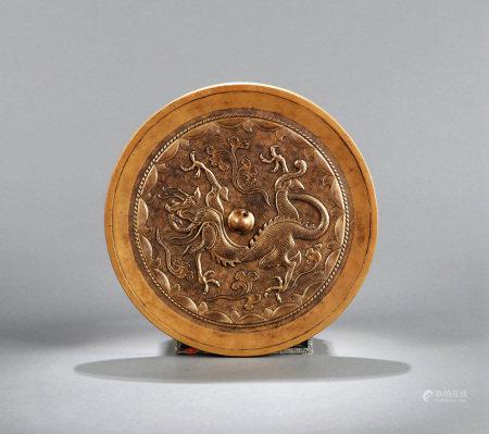 A CHINESE DRAGON BRONZE MIRROR, 18TH CENTURY