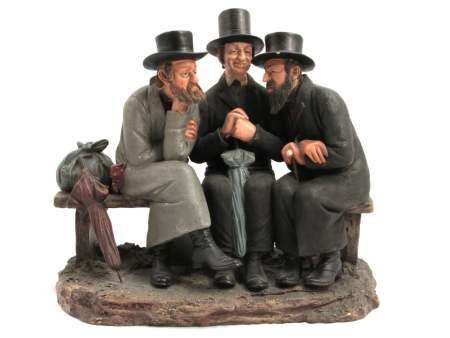 A PORCELAIN GROUP OF THREE JEWISH MEN LATE 19TH C