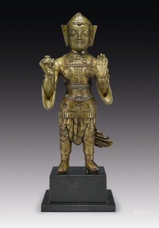 A COPPER ALLOY FIGURE OF A GUARDIAN WITH COPPER INLAY,  TIBET, 13TH CENTURY