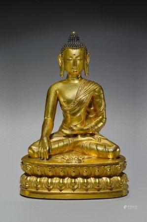 A GILT COPPER ALLOY FIGURE OF BUDDHA SHAKYAMUNI,  TIBET, 15TH CENTURY