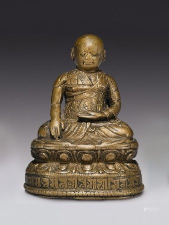 A COPPER ALLOY FIGURE OF A LAMA WITH COPPER INLAY,  TIBET, 16TH CENTURY