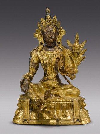 A GILT COPPER ALLOY FIGURE OF GREEN TARA,  TIBETO-CHINESE, 17TH/18TH CENTURY