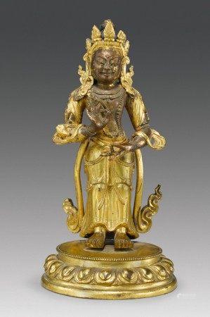 A GILT COPPER ALLOY FIGURE OF A STANDING BODHISATTVA,  TIBETO-CHINESE, 18TH CENTURY