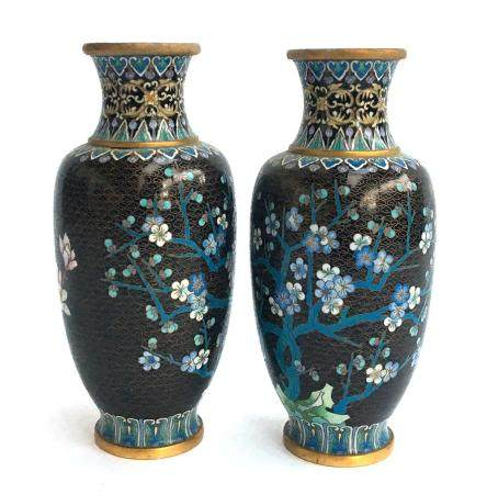 A pair of late 19th century Chinese cloisonné enamel vases on hardwood stands, depicting cherry