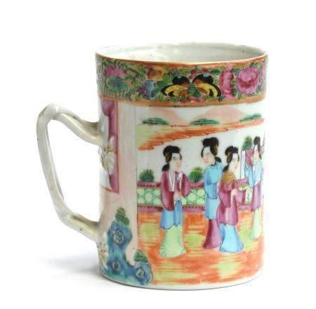 A Cantonese famille rose cylindrical mug, decorated with court scenes, heightened in gilt, 13cm high