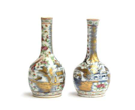 A matched pair of Chinese bottle vases, the first decorated with butterflies and dragons, 16cm high;