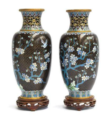 A pair of late 19th century Chinese cloisonné enamel vases on hardwood stands, each 25.5cm high