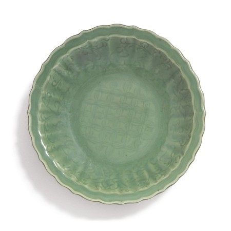 A 'LONGQUAN' CELADON-GLAZED 'DIAPER AND FLORAL' BARBED-RIM CHARGER,  MING DYNASTY