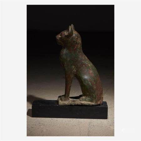 An Egyptian bronze figure of a seated cat, Late Period, circ
