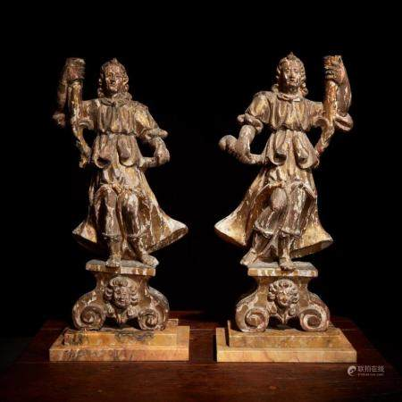 A pair of Italian Baroque gilt and polychrome decorated figu