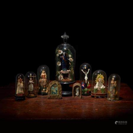 A collection of German blown glass and wax saints, Most 19th