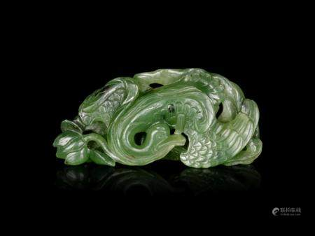 A Spinach Green Jade 'Goose and Lotus' Carving