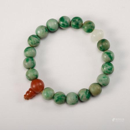 A Chinese Jadeite Beads Bracelet