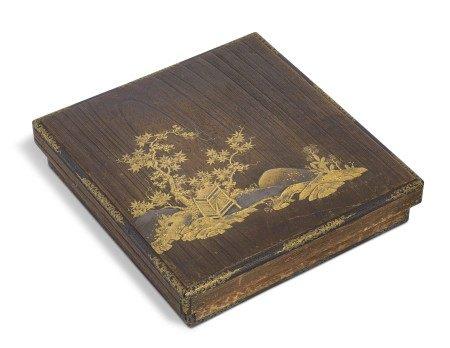 A LACQUERED PAULOWNIA WOOD WRITING BOX (SUZURIBAKO)