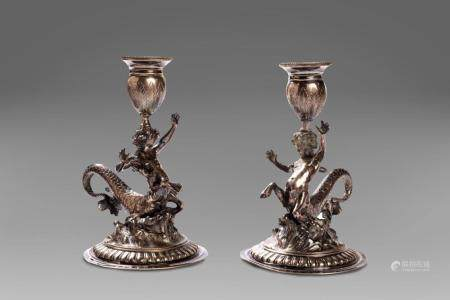 Pair of silver candle holders with young tritons, Genoa, ear