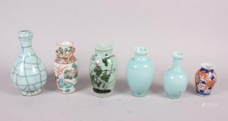 "A pale glazed crackle glazed vase, 6 1/2"" high, two other pale glazed vases, a Canton vase, 5"" high,"