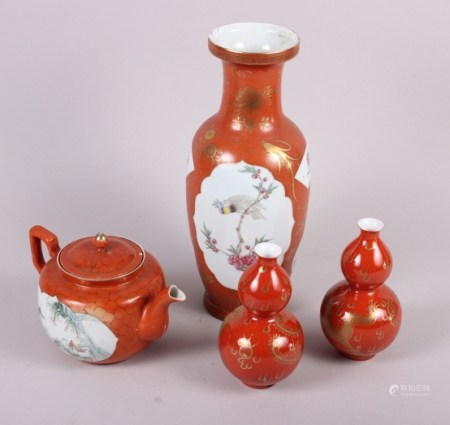 """A Chinese baluster vase, decorated panels of birds and flowers, 11 3/4"""" high, a similar teapot and a"""