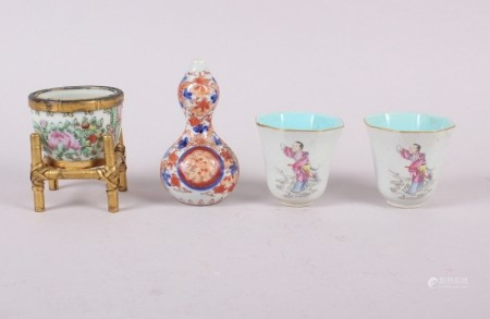 """A miniature Imari double gourd vase, 4"""" high, a famille rose miniature planter with stand and a"""