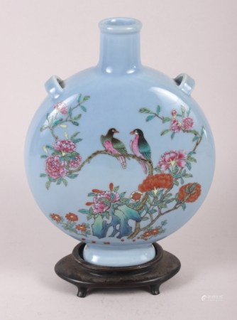 """A Chinese moon flask with famille rose decoration of birds and flora, 9 1/2"""" high, with hardwood"""