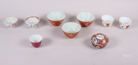 Three Chinese orange glazed tea bowls with seal marks to base, two pairs of tea bowls, and another