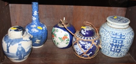 """A Chinese blue and white ginger jar and cover, 7 1/2"""" high, two smaller ginger jars, a sprinkler"""