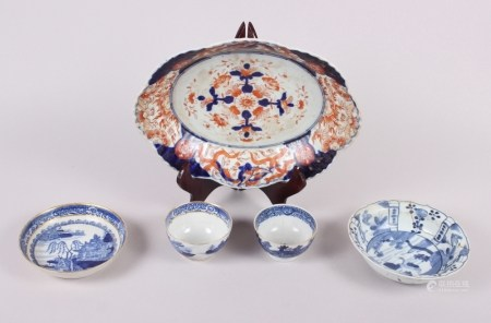 A Chinese tea bowl decorated with cranes, three pieces of Chinese export blue and white china and an