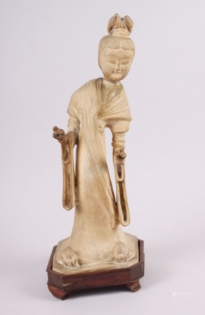 """A Chinese """"Tang"""" pottery figure of a dancer in flowing robes, 14 1/2"""" high, on wooden base ("""