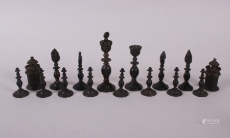 """A 19th century Indian turned ivory and horn chess set, king 4 1/2"""" high, together with parquetry"""