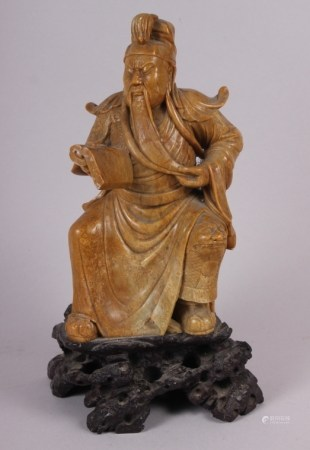 """A Chinese soapstone carved figure of an immortal, 11 1/2"""" high"""