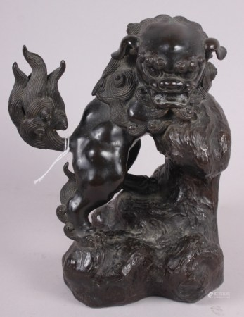 """A Chinese bronze figure of a standing lion, 8"""" high"""