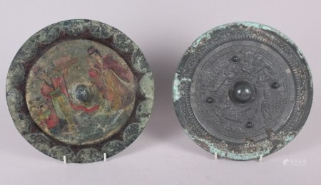 """A Chinese bronze mirror with hand painted figure decoration, 9 3/4"""" dia, and a similar mirror with"""