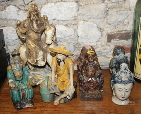 Two Chinese ceramic busts, two Chinese figures of seated men, two soapstone figures and a