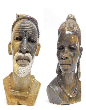 Two African carved heads of a man and a lady from the Mashona tribe, one signed R Mugari to base (
