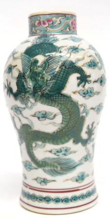 Oriental vase decorated in famille vert palette with a dragon chasing the flaming pearl