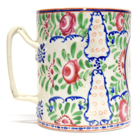 Chinese porcelain tankard with interlaced handles decorated in polychrome with floral sprays