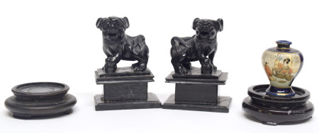 Pair of Chinese carved wooden lions on rectangular bases, together with a miniature Satsuma vase, (